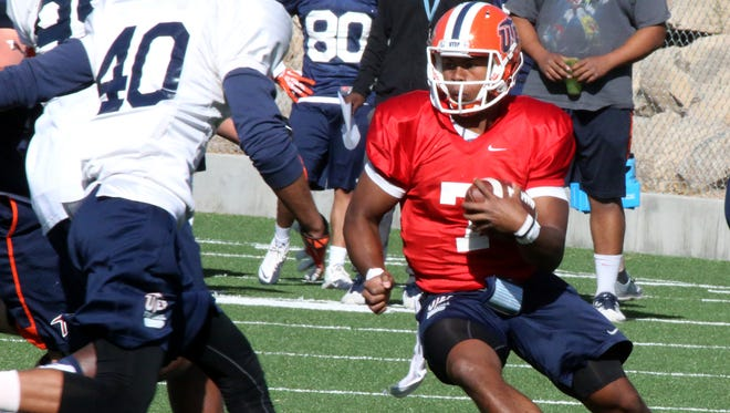 UTEP quarterback Kavika Johnson, 7, keeps the ball on a play during Wednesday's spring practice at Glory Field.