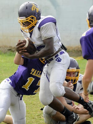 Tallassee tailback D.J. Rivers is working out with the defensive backs for the South football team during Alabama All-Star Sports Week.