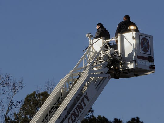 Retired North Myrtle Beach firefighter, Mark Middleton, left, pilots a drone while looking for missing Jayden Morrison, in Little River, S.C., on Thursday, Dec. 25, 2014.