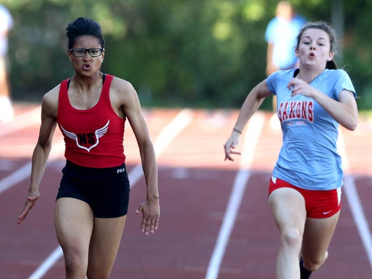 West Salem's Lucy Jolivette, from left, Rebekah Miller and South Salem's Chloe Bryant compete in the finals of the girls 100 meter dash at the Greater Valley Conference District Championships track and field meet at McMinnville High School on Friday, May 13, 2016. Miller placed first, Jolivette second and Bryant third.