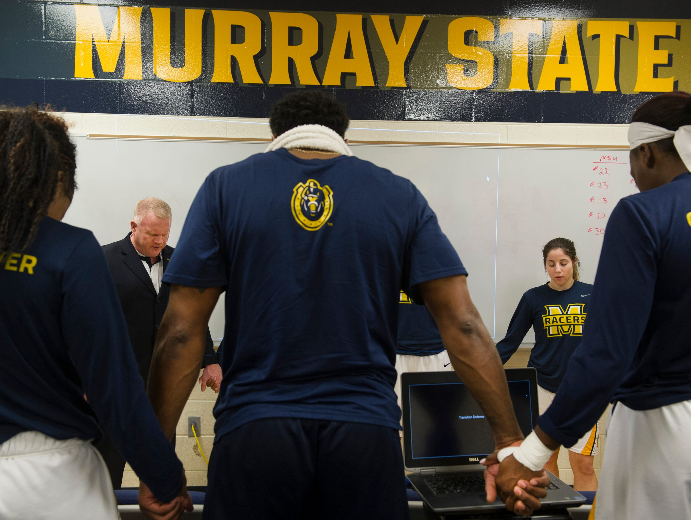 The Murray State Racers gather for a prayer before