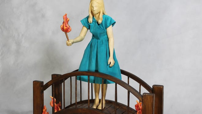 """""""Burning Bridges"""" by Deborah Unger will be featured in """"Water Under the Bridge,"""" an exhibit of her sculpture and the paintings of Ann Altman at the Lunaria Gallery through Aug. 2."""