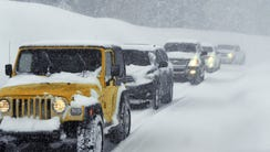 Vehicles make their way down the Mt. Rose Highway near
