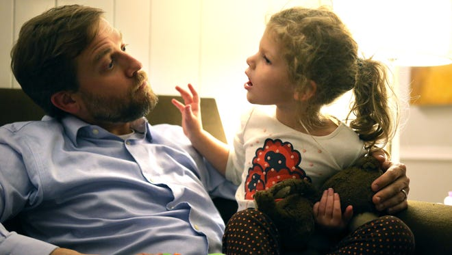Frazer Gieselmann works on vocalization with daughter Elle, 4, who is part of a clinical study for Batten disease.