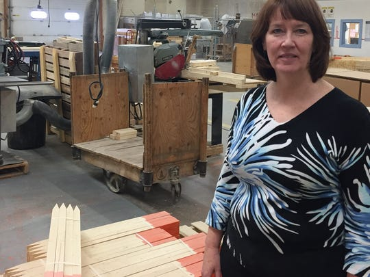 Barbara Walsh, chief executive officer of Helena Industries, stands in the woodshop which is now vacant.