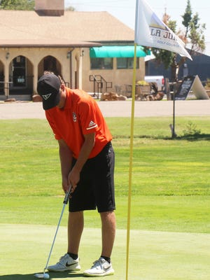 Nate Paolucci of the La Junta High School boys golf team putts on the ninth green at the La Junta Invitational Friday at the golf course. Paolucci placed sixth as an individual and the Tigers were second as a team.