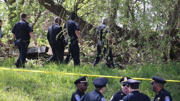 Police at the scene near Hudson and Skuse streets on Thursday, May 7, 2015.