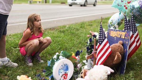 April Baker visits the memorial of Bridgette Shepherd with her grandmother.