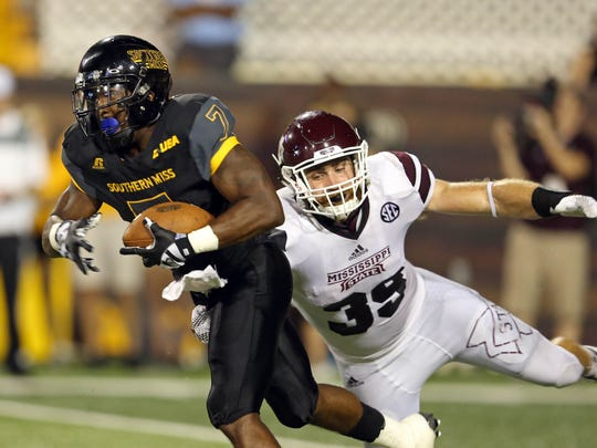 Southern Miss running back Justice Hayes is defended