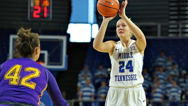 MTSU forward Rebecca Reuter puts up a shot against Lipscomb on Sunday at Murphy Center.