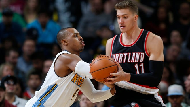 Portland Trail Blazers forward Meyers Leonard (11), right, reaches out for ball as Denver Nuggets guard Randy Foye (4) covers in the second half of an NBA basketball game Monday, Nov. 9, 2015, in Denver. The Nuggets won 108-104. (AP Photo/David Zalubowski)