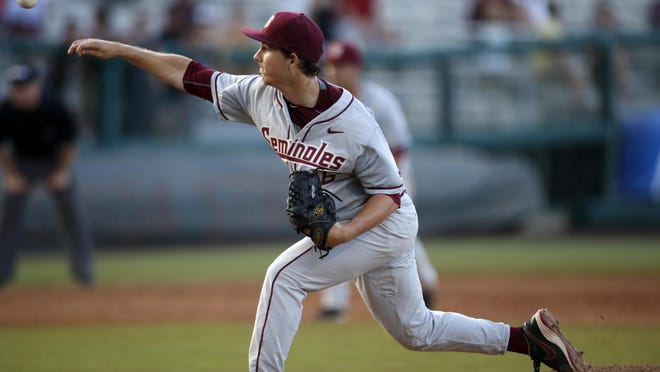 FSU's Drew Carlton pitches against College of Charleston during their final game of the NCAA Regional at Dick Howser Stadium on Monday.