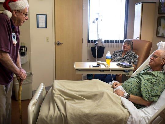 Volunteer Sam Allen talks with patient Leroy Sweet