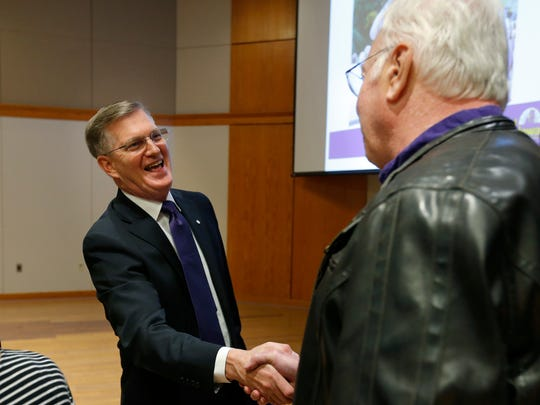 University of Northern Iowa presidential candidate Mark Nook talks with presidential search faculty co-chair Daniel Power after the Presentation and Open Forum at Maucker Union Thursday, Dec. 1, 2016, in Cedar Falls, Iowa. (Matthew Putney /The Courier via AP)