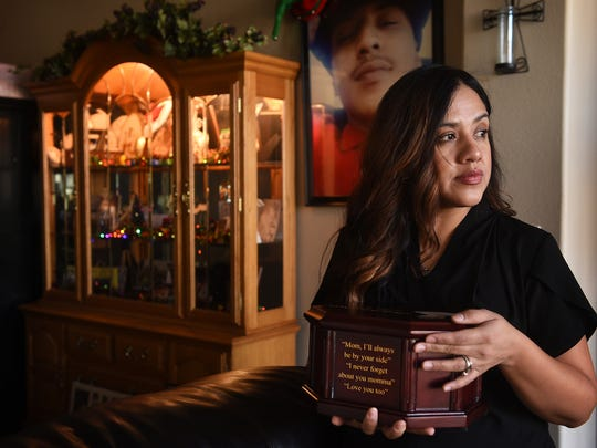 Irene Reyes, mother of Anthony Herrera, poses for a portrait while holding the remains of her son at her home in Spanish Springs on Dec. 27, 2017. Herrera was shot and killed on Aug. 23, 2017 as a result of an attempted robbery.