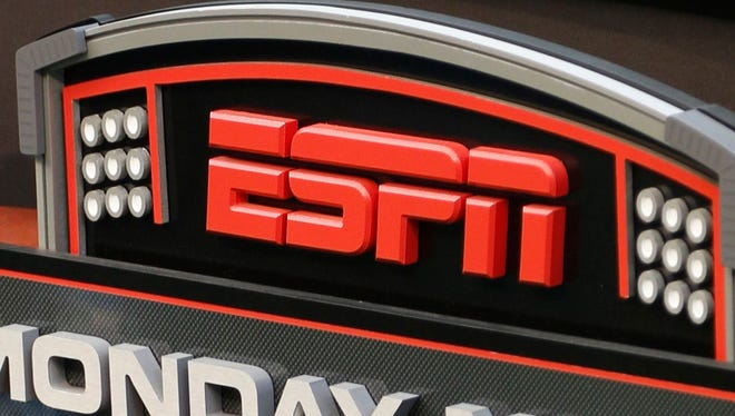 This Sept. 16, 2013 file photo shows the ESPN logo prior to an NFL football game between the Cincinnati Bengals and the Pittsburgh Steelers.