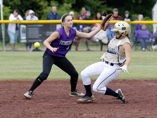 Notre Dame's Izzy Milazzo slides into second base as the ball gets past Ticonderoga's Haleigh Wright.