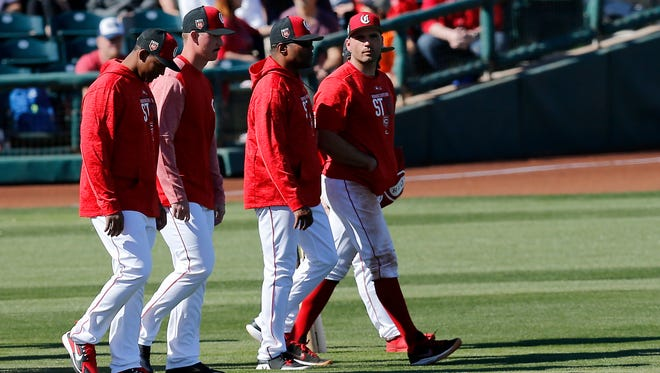 Cincinnati Reds first baseman Joey Votto (19) leads the group of Reds pleayer leaving early after the sixth inning of the Spring Training  game between the Cincinnati Reds and the Colorado Rockies at Goodyear Ballpark in Goodyear, AZ, on Saturday, Feb. 24, 2018.