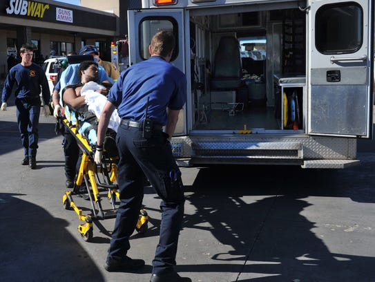 Emergency medical technicians work to transport Charles