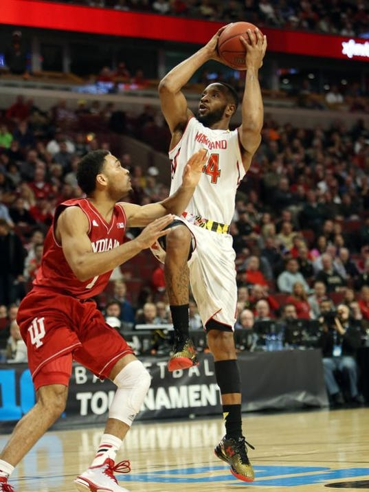 Dez Wells scores 22, No. 8 Maryland squeezes by Indiana 75-69
