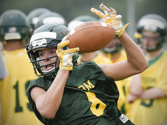 Sauk Rapids receiver Ben DeMars catches a pass during