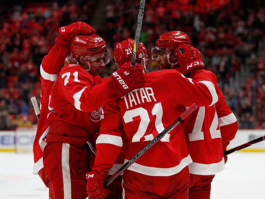 Red Wings left wing Andreas Athanasiou (72) celebrates