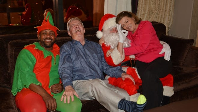 Beamers get Santa, elf visit on Christmas Eve at Sam's Town Hotel and Casino.