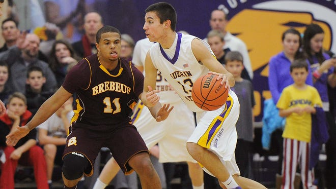FILE - Brebeuf Jesuit point guard P.J. Thompson (left) became Purdue's fifth signing of the 2014 recruiting class.