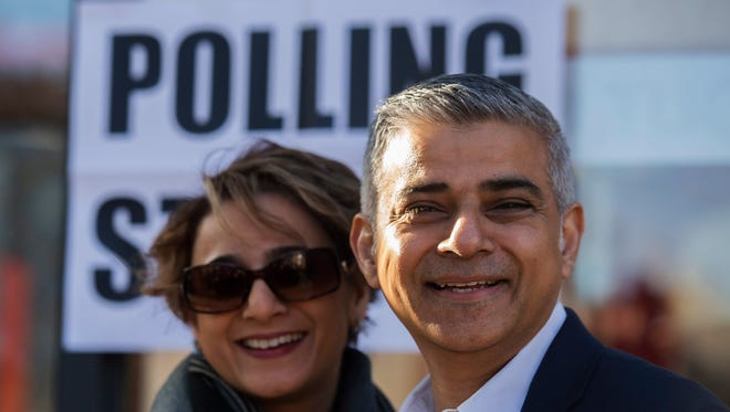 British Labour party candidate for mayor of London Sadiq Khan poses with his wife Saadiya Khan after voting at a polling station in south London, Britain, on May 5, 2016.