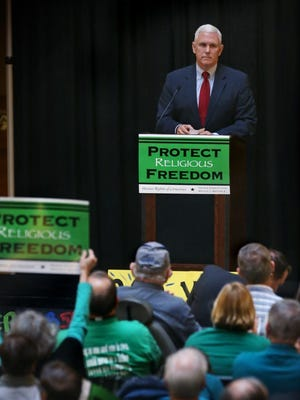 Indiana Gov. Mike Pence speaks to supporters of religious liberty measure at a noon rally in the North Atrium of the Statehouse in Indianapolis on Monday, Feb. 9, 2015, prior to a Senate Judiciary Committee hearing on the legislation.