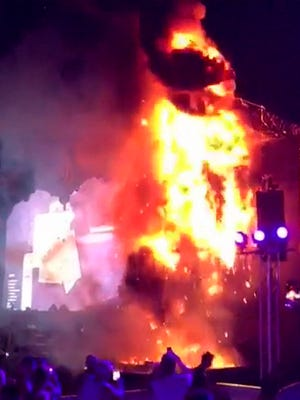 A video grab made from footage by Angel Rodao, via Instagram account @mayde_luna, shows flames and smoke at Tomorrowland music festival in Santa Coloma de Gramenet near Barcelona. Organizers blamed the fire Saturday night on a technical malfunction.