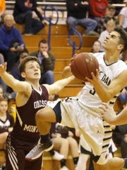 Justin Bauco drives to the hoop for Notre Dame in a
