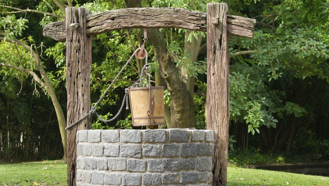 Antique water well.