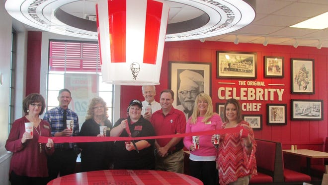 Kentucky Fried Chicken, Marion recently marked their newly renovated building with a ribbon cutting joined by the Marion Area Chamber of Commerce Ambassadors, Brian Wheeler, Operations Manager and Rachel West, Manager.  The new look at store, 1917 Marion-Mount Gilead Road, maintains KFC's traditional red-and-white motif and adds bucket-shaped chandeliers and photos of Colonel Sanders.Store hours are 10:30 a.m. to 10 p.m.daily and weekends.