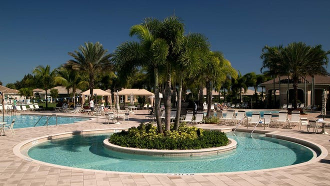 The clubhouse and swimming pools at Valencia Reserve in suburban Boynton Beach.