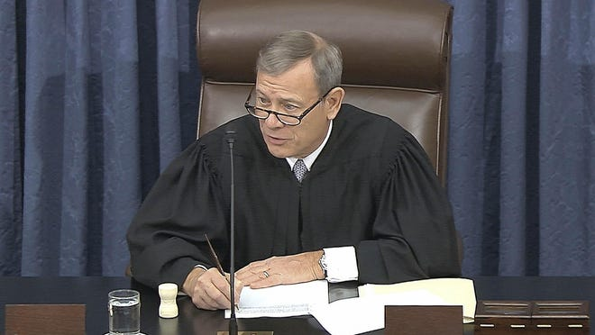 In this image from video, presiding officer Supreme Court Chief Justice John Roberts speaks during the impeachment trial against President Donald Trump in the Senate at the U.S. Capitol in Washington, Wednesday, Jan. 22, 2020.