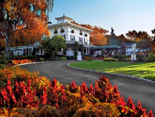 The Homestead Inn's winding driveway welcomes travelers
