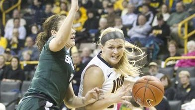 The Iowa Hawkeyes women's basketball team will try to continue their streak of 24 consecutive games with three or more players scoring in double figures Thursday night against Illinois at Carver-Hawkeye Arena. Melissa Dixon is averaging 13.8 points for Iowa this season.