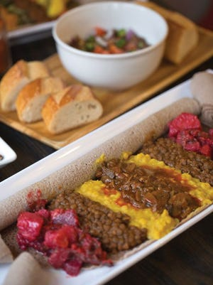 The mushroom combo with beets, lentils, split peas and mushrooms, foreground, and the ful at Nile Vegan