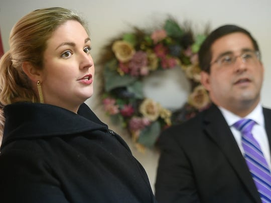 """""""I hope to be as great as my dad and my grandfather have been,"""" said Grace Keffer Ireland, left, seen here during a recent service at the West Market Street funeral home."""