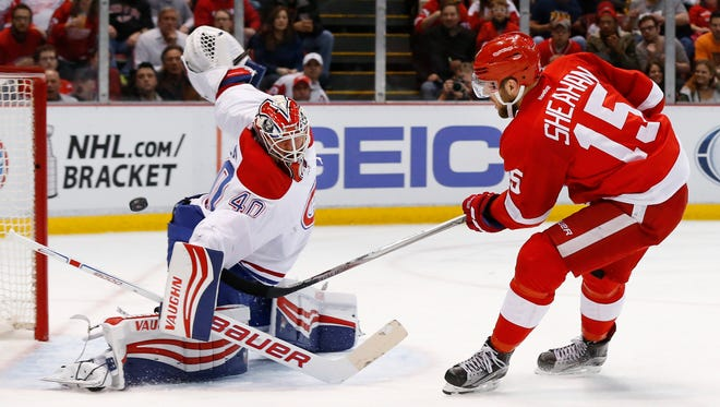 Red Wings center Riley Sheahan (15) scores on Canadiens goalie Ben Scrivens (40) in the second period of the Wings' 4-3 win Thursday at Joe Louis Arena.