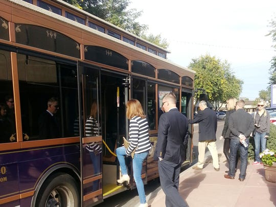 Visitors board the trolley as part of the Scottsdale Trolley Food Tour by Taste it Tours Taste it Tours.