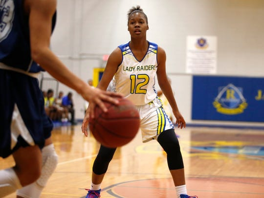 Rickards' Tamia Riles takes up full court defense against PC Arnold during their Region 1-5A quarterfinal game at Rickards High School on Thursday.