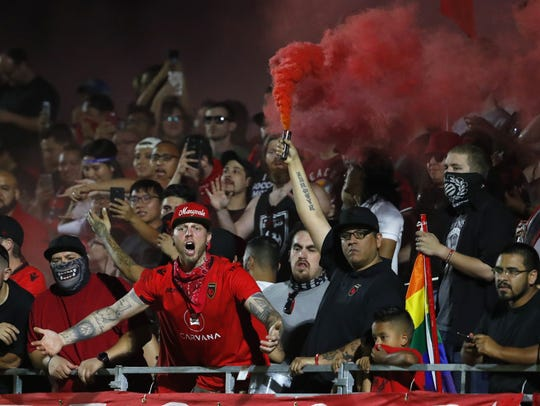 Phoenix Rising fans protest a goal being taken away