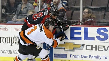 Cyclones forward Tommy Mele (18) and Komets defender Gabriel Beaupre (3) collide on the boards in the first period of the Kelly Cup Playoff West Conference quarterfinal game between the Cincinnati Cyclones and the Fort Wayne Comets at US Bank Arena in downtown Cincinnati, on Wednesday, April 20, 2016.