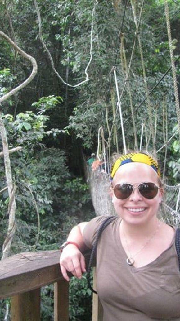 Jessica Hawk '15 walks across one of the many treetop canopies at Kakum National Park in Ghana. (Photo courtesy of Hawk)