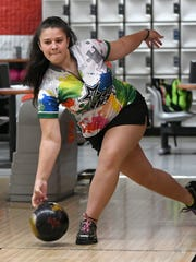 Bowler Crystal Elliott practices at Brunswick Harbour Lanes in Melbourne.