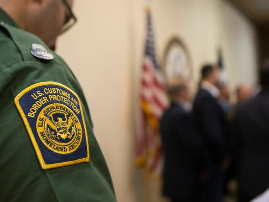 A U.S. Border Patrol agent  listens as U.S. Senators Ted Cruz and John Cornyn speak during a press counfrernce at the border patrol station in Weslaco, Texas to discuss immigration policy on Friday, June 22, 2018.