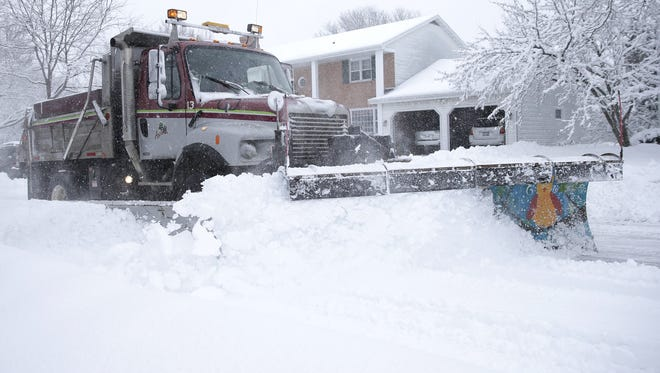 A snow plow clears a street while snowstorm rolled through Appleton on Feb. 2.