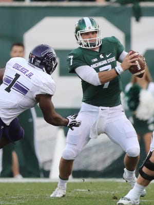 Michigan State quarterback Tyler O'Connor came in off the bench Saturday and had a good game, throwing for 281 yards.
